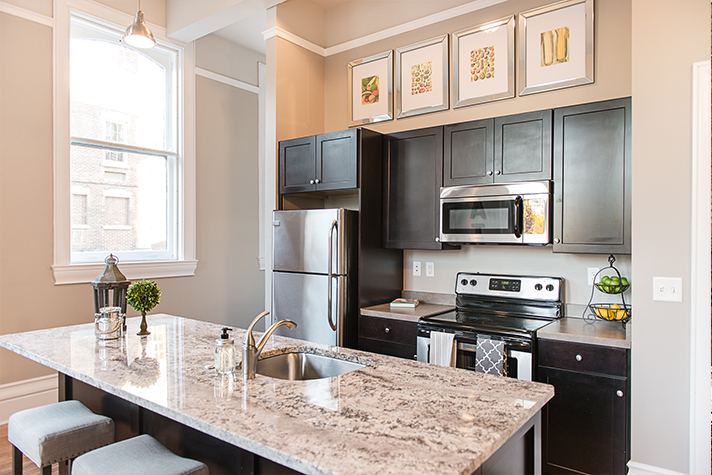 Kitchen with Stainless Steel Appliances at the 300 Alexander Apartments in Rochester, New York