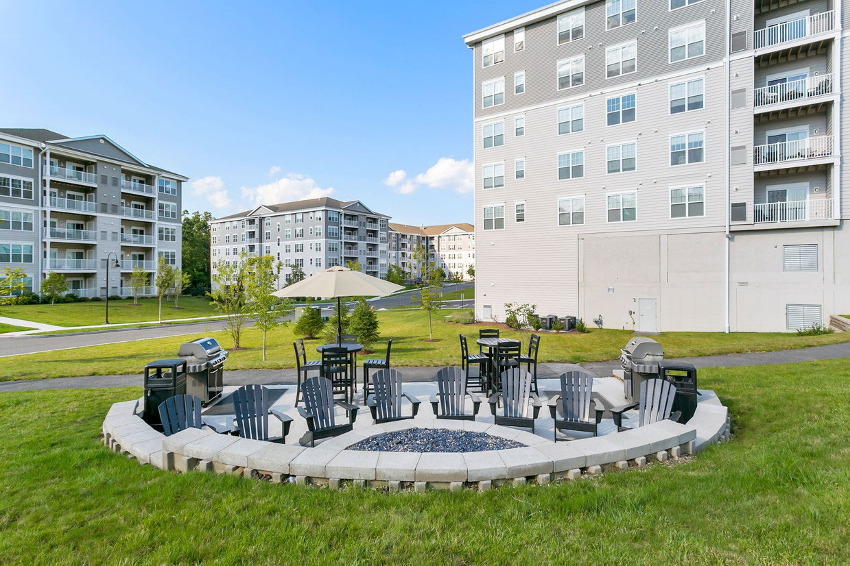 Fire Pit and Lounge Chairs at Abbey Lane Apartments in Danbury, Connecticut