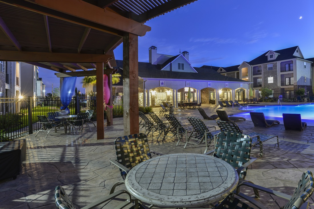Sparkling Pool Area of the Aria at Rollingbrook Apartments in Baytown, TX
