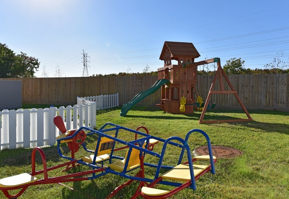 Children's Play Area at the Aria at Rollingbrook Apartments in Baytown, TX