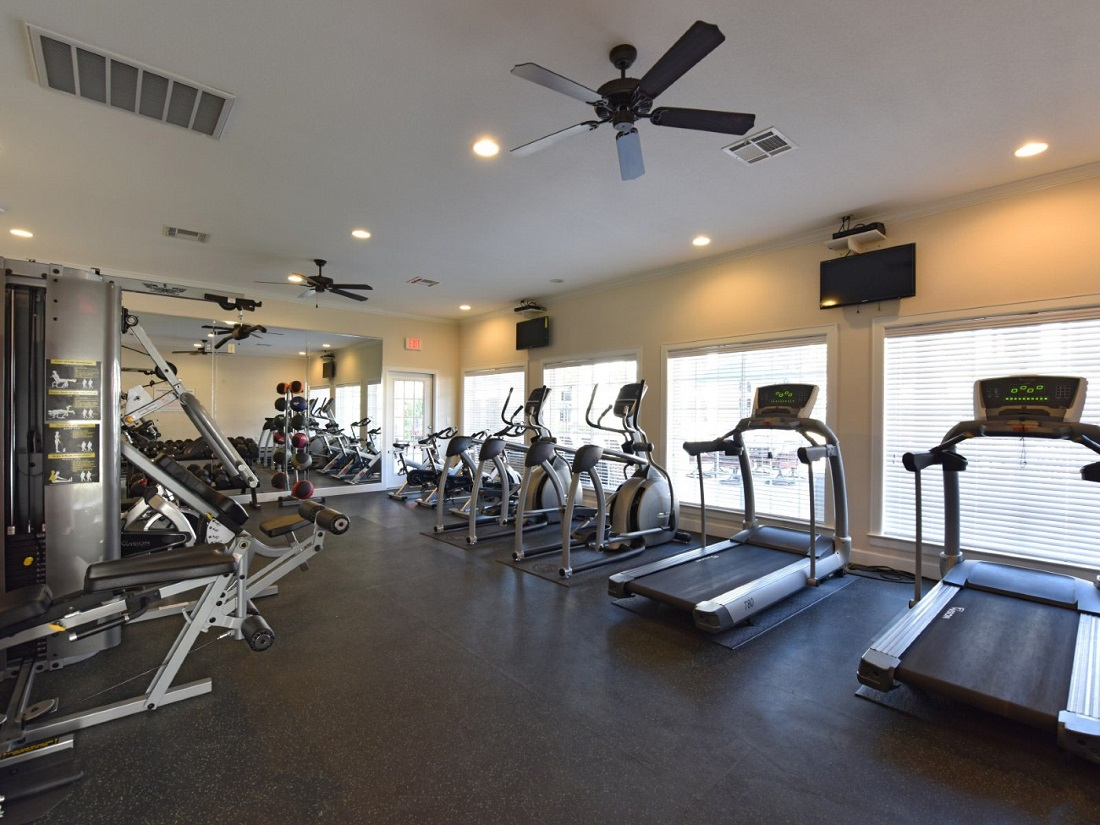 Fully Equipped Fitness Center at the Aira at Rollingbrook Apartments in Baytown, TX