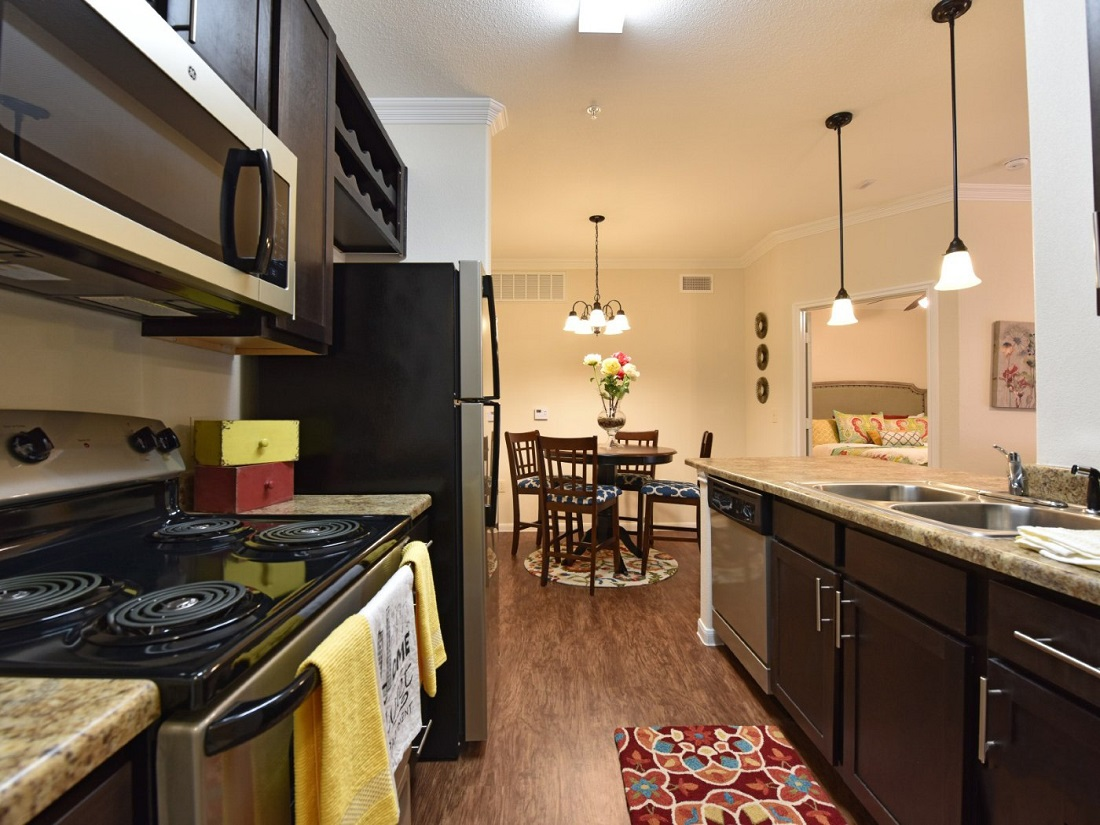 Fully Equipped Kitchen at the Aira at Rollingbrook Apartments in Baytown, TX