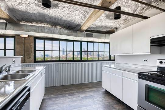 Fully Equipped Kitchen at American Beauty Mill Apartments in Dallas, Texas