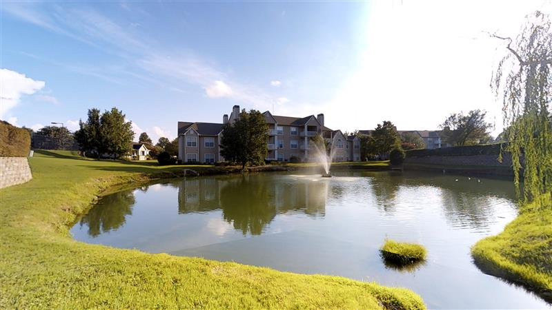 Beautiful Pond with Fountain at Appling Lakes Apartments in Cordova, Tennessee