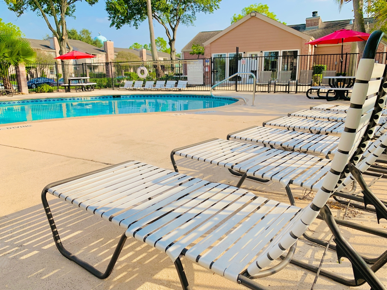 Lounge Chair beside the Pool at Ashford Pointe Apartments in Houston, Texas