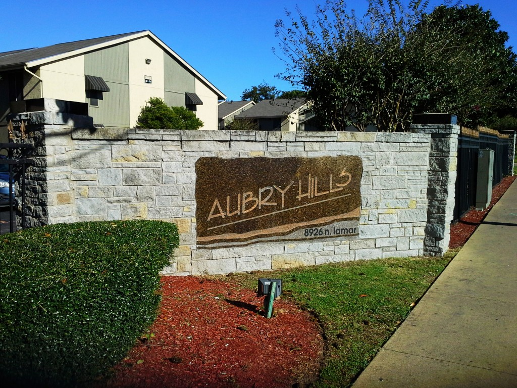 Front Facade with Landscaping at Aubry Hills Apartments in Austin, TX