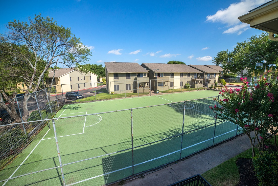 Fenced-In Sports Court at Aubry Hills Apartments in Austin, TX