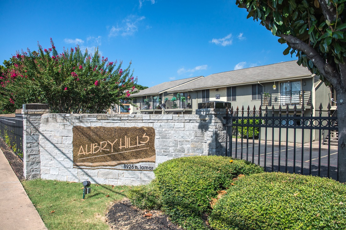Property Sign at Aubry Hills Apartments in Austin, TX