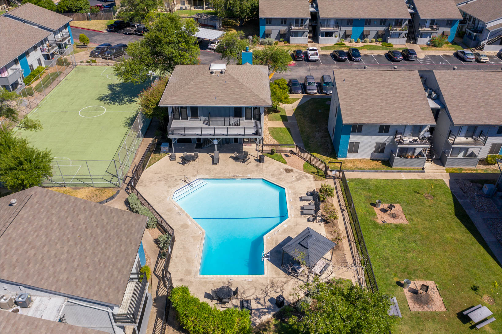 Sparkling Swimming Pool and Sports Court at Aubry Hills Apartments in Austin, TX
