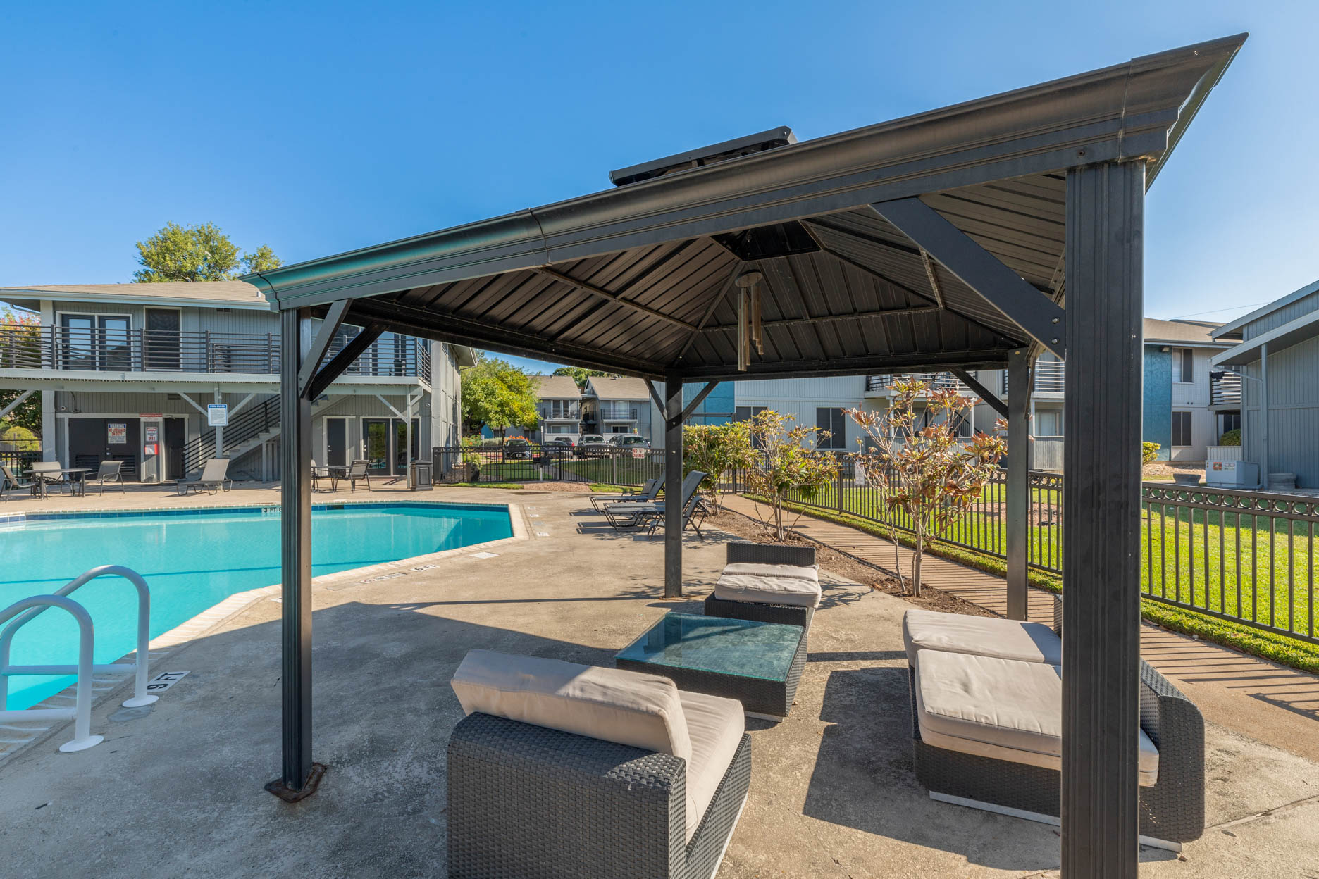 Sparkling Swimming Pool and Lounge Area at Aubry Hills Apartments in Austin, TX