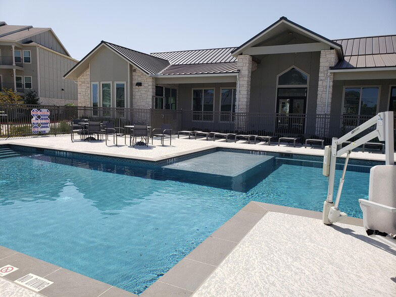 Poolside Lounge Area at Colorado Creek Apartment Homes in Austin, TX