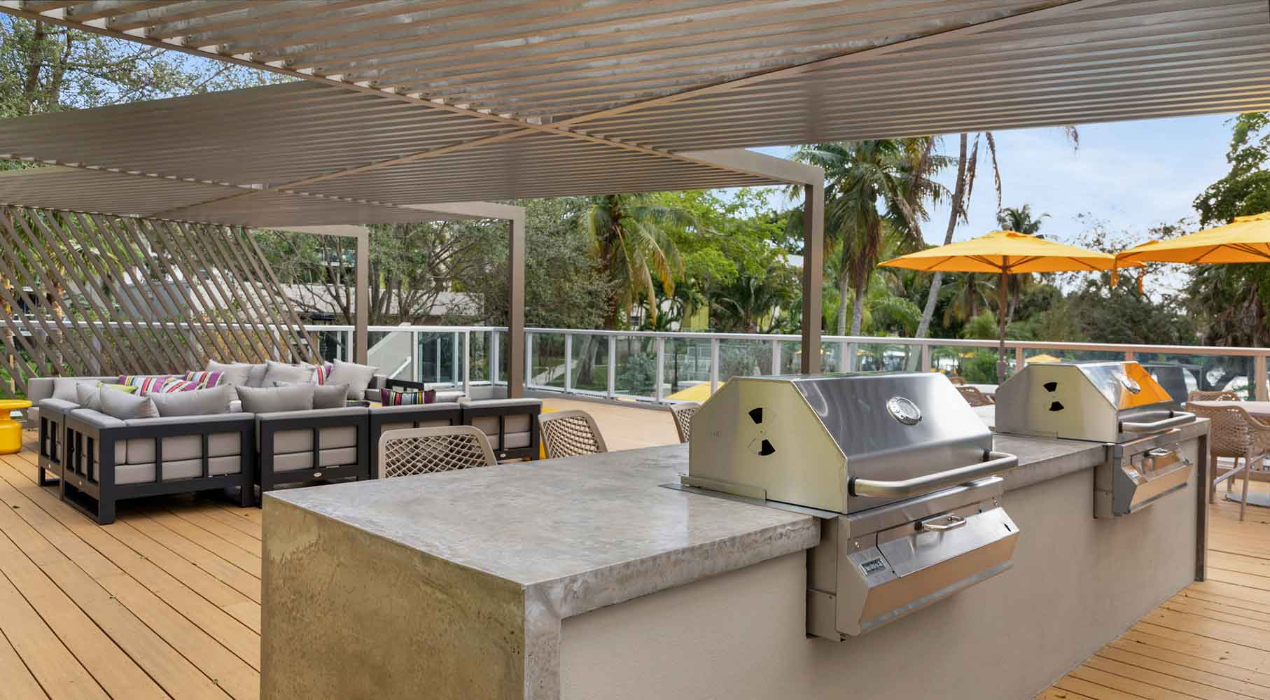 Outdoor Grilling Area at Nottingham Pine Apartments in Plantation, FL