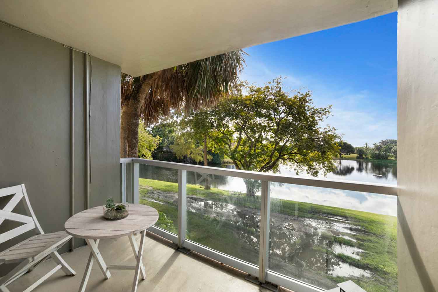 Private Patio with View at Nottingham Pine Apartments in Plantation, FL