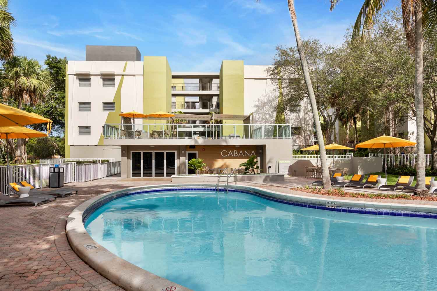 Pool Area with Lounge Chairs at Nottingham Pine Apartments in Plantation, FL