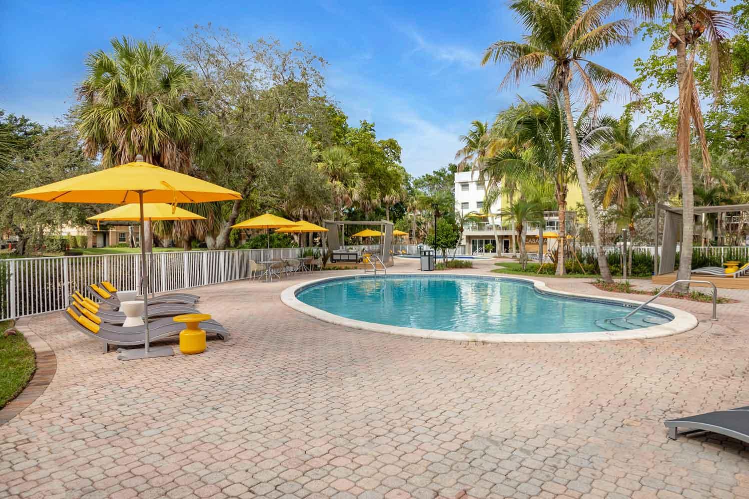 Lagoon-Like Swimming Pool at Nottingham Pine Apartments in Plantation, FL