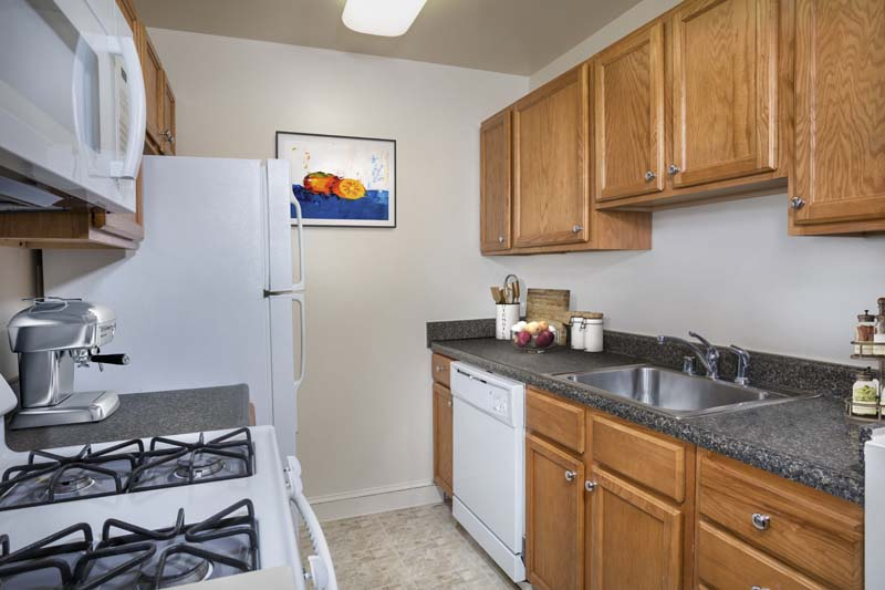 Fully-equipped kitchen at Barcroft Plaza Apartments in Falls Church, VA