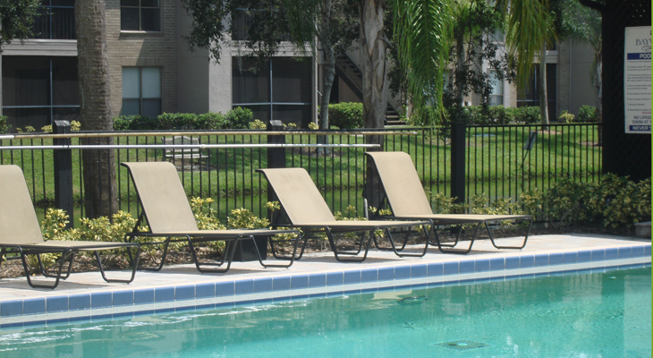 Lounge Area Next to Pool at the Baywater Apartments in Tampa, FL
