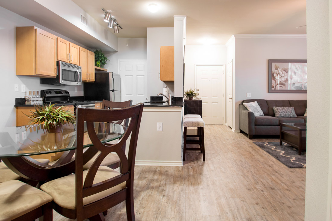 Kitchen & Living at Beaumont Trace Apartments in Beaumont, TX