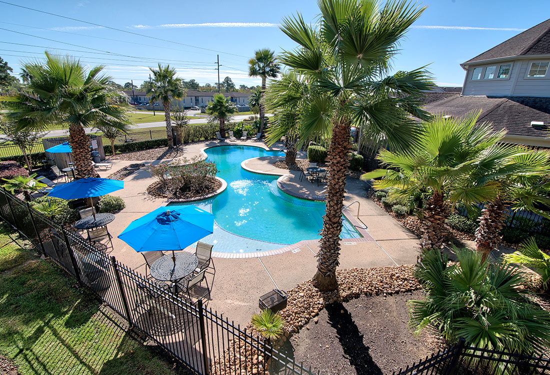 Outdoor Swimming Pool at Beaumont Trace Apartments in Beaumont, TX