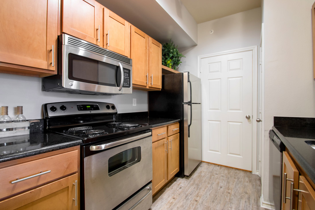 Kitchen at Beaumont Trace Apartments in Beaumont, TX