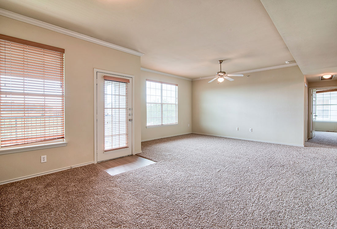 Spacious Living Room at Beaumont Trace Apartments in Beaumont, TX
