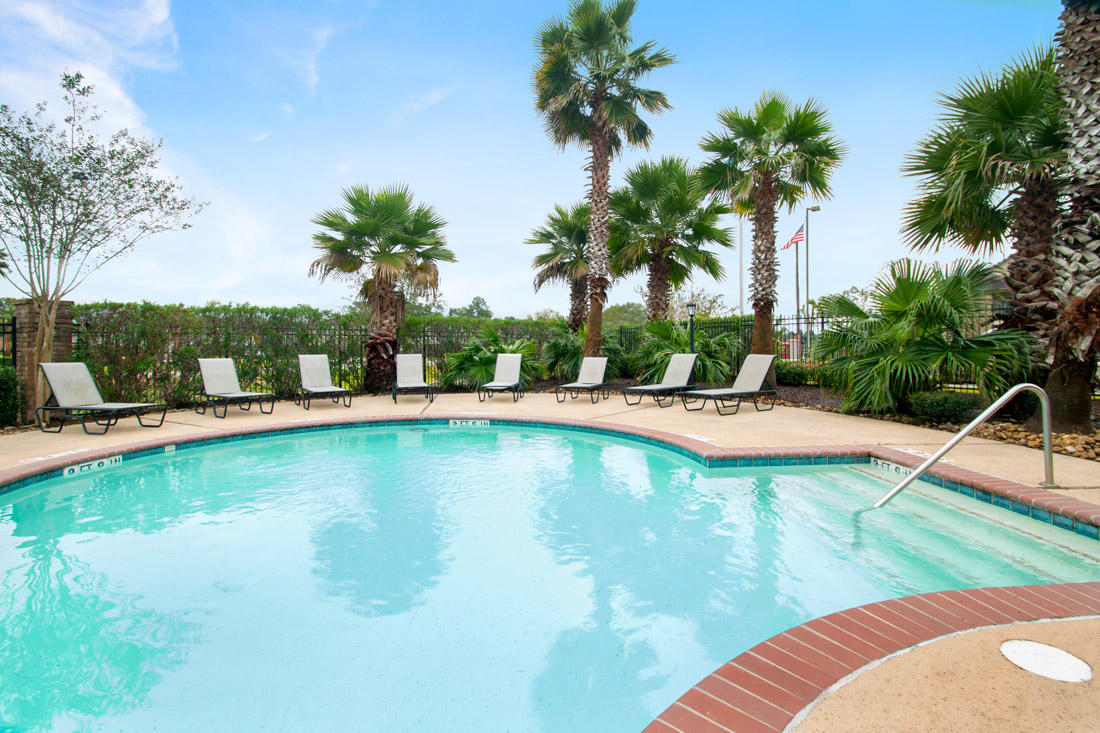 Sparkling Outdoor Pool at Beaumont Trace Apartments in Beaumont, TX