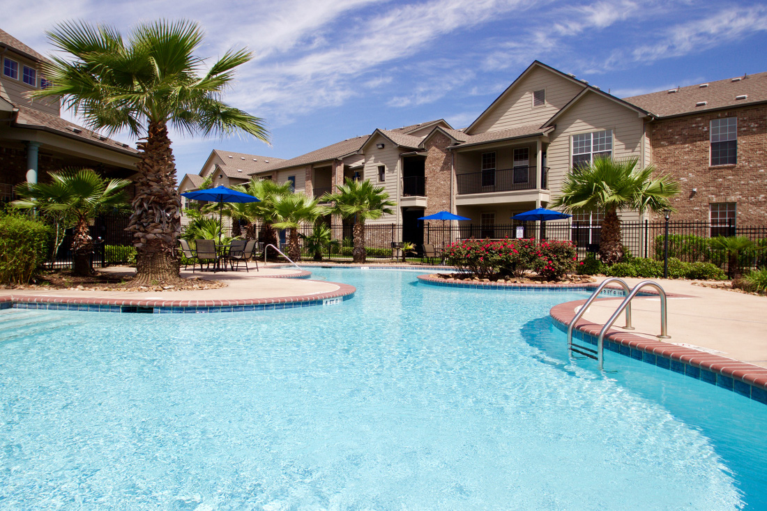Lounge Area and Pool at Beaumont Trace Apartments in Beaumont, TX