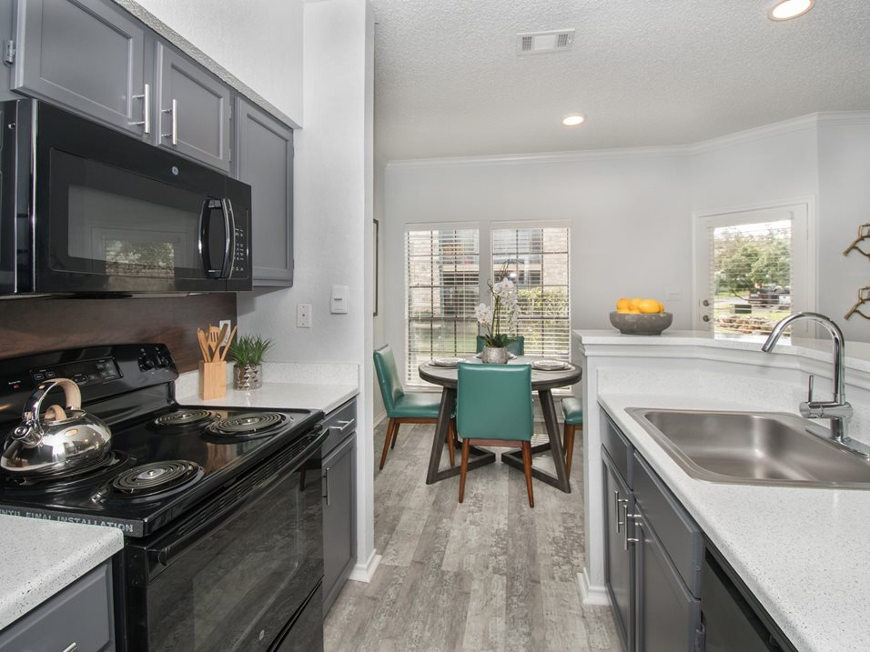 Galley Style Kitchen at Blair at Bitters Apartments in San Antonio, TX