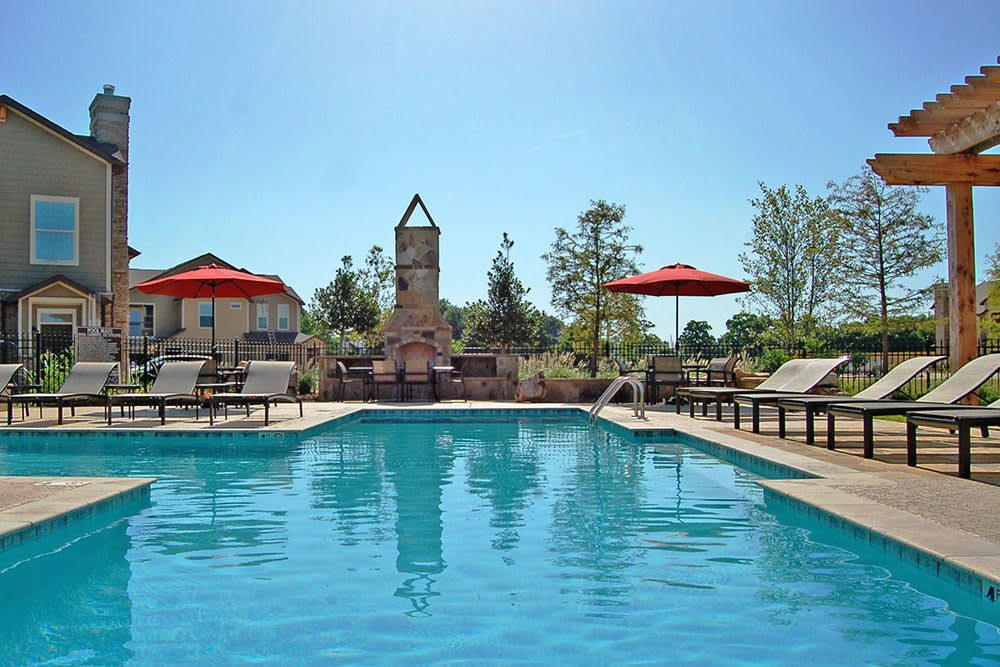 Pool Area with Furniture at The Boulders on Fern Apartments in Shreveport, LA