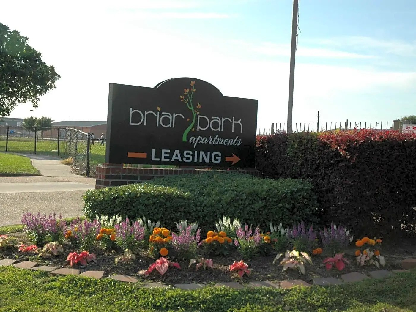 Welcome Signage with Logo at Briar Park Apartments in Houston, Texas