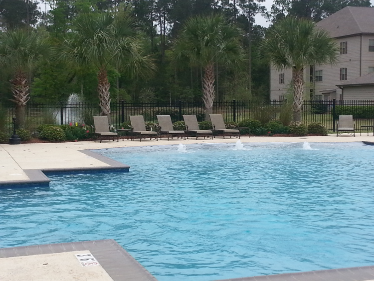Pool with Fountains at Brookstone Park Apartments in Covington, LA
