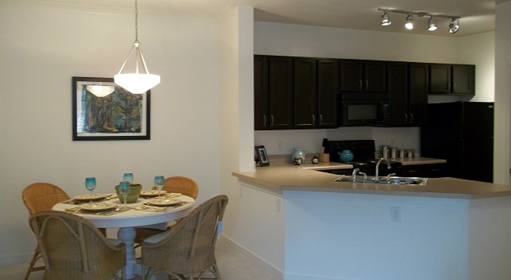 Kitchen and Dining Areas at Brookstone Park Apartments in Covington, LA