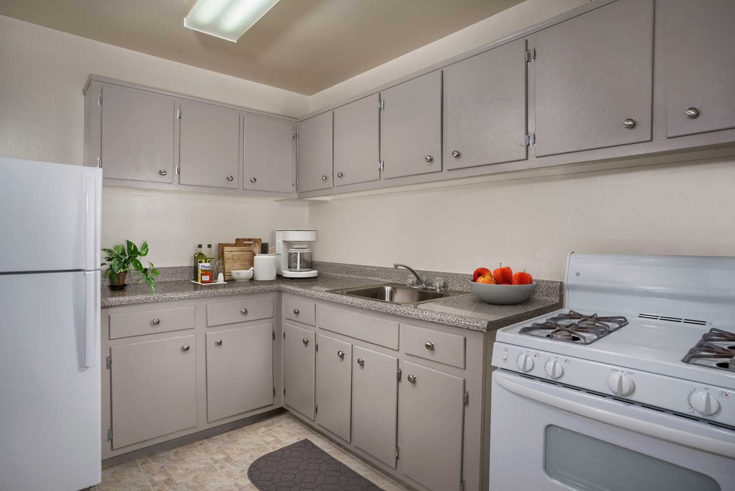 Kitchen with gas range at Carrollon Manor Apartments in New Carrollton, MD