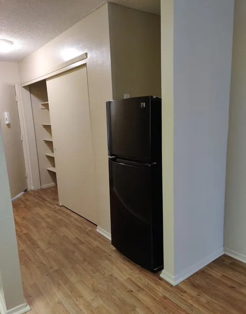 Black Kitchen Appliances at Casitas De Bella Apartments in Santa Fe, NM