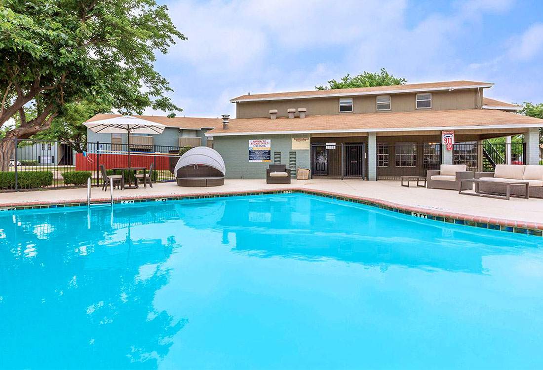 Swimming Pool with Patio and Grill at Cedar Creek Apartments in Abilene, Texas