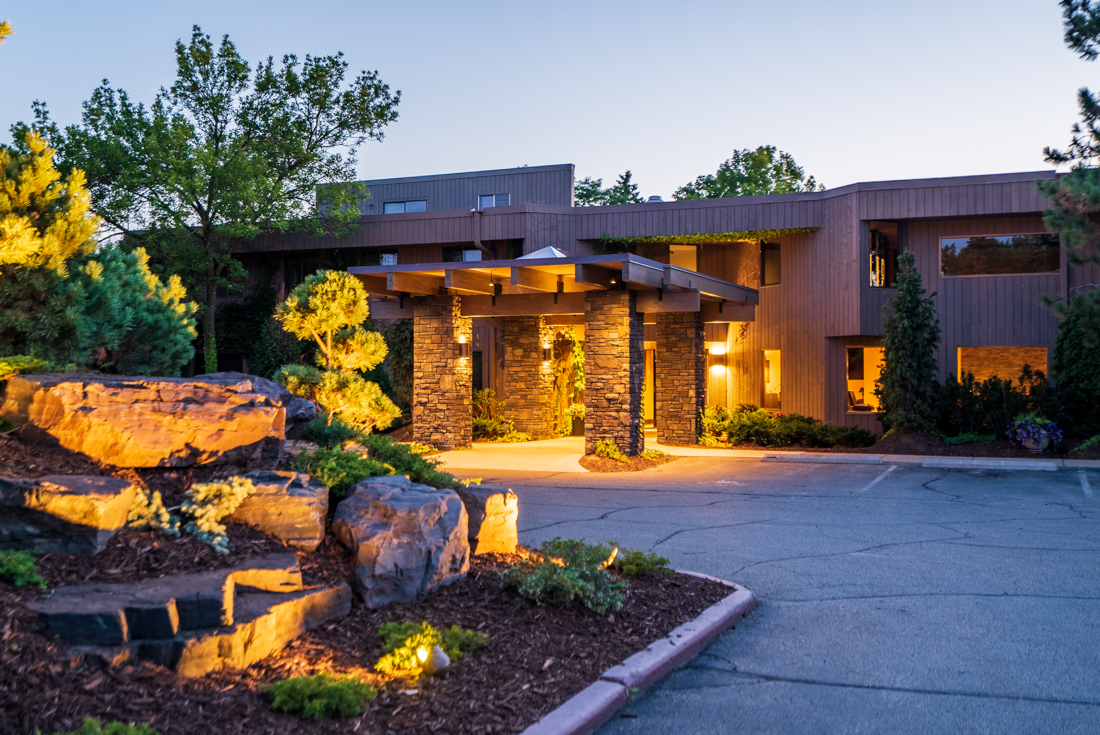From parking space to entrance at Cedars of Edina Apartments in Edina, MN
