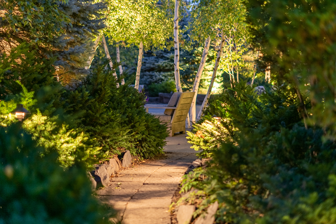 Passage with lots of greens at Cedars of Edina Apartments in Edina, MN