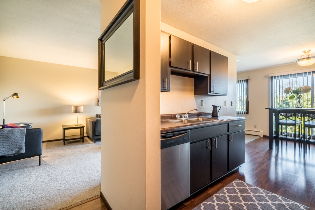 Open Kitchen, Dining, and Living Area at Cedars of Edina Apartments in Edina, MN
