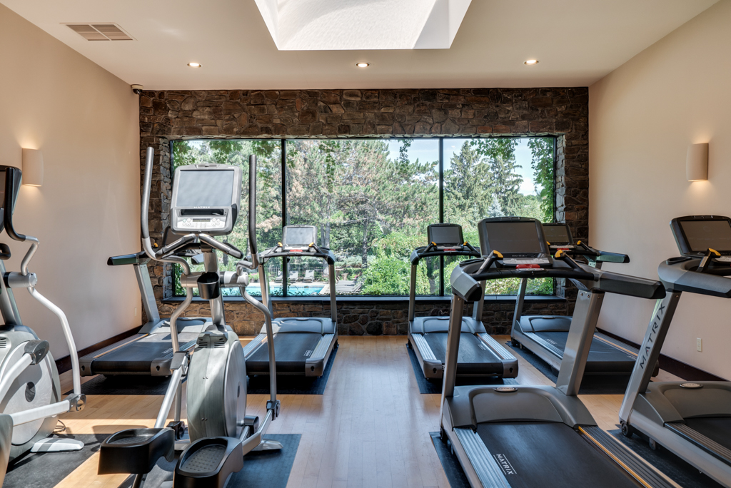 Cardio Equipment Room with Beautiful View at Cedars of Edina Apartments in Edina, MN