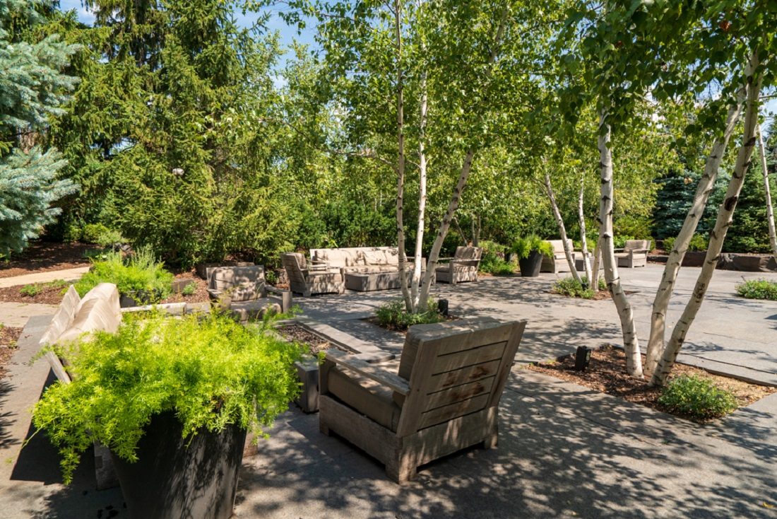 Serene Birch Park Seating Area with Fire Tables at Cedars of Edina Apartments in Edina, MN