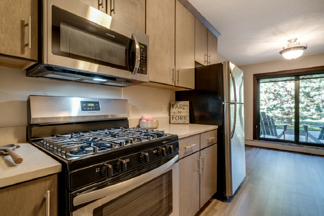 Five Burner Gas Range in Select Apartments at Cedars of Edina in Edina, MN