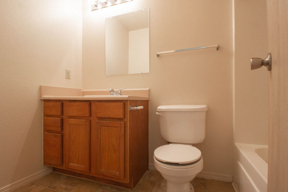 Spacious Bathrooms with Shower and Tub Combination at Chapel Ridge of Johnston in Johnston, IA