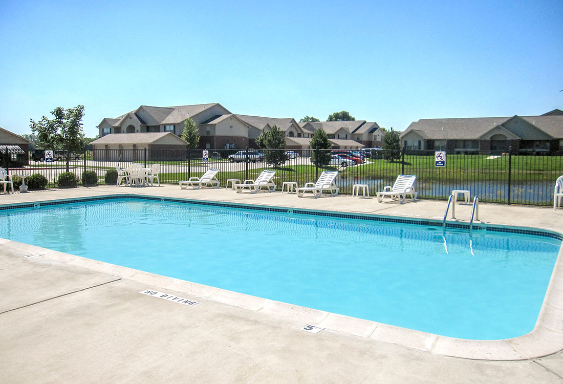 Pool Lounge Area at Chapel Ridge of Council Bluffs Apartments in Council Bluffs, IA