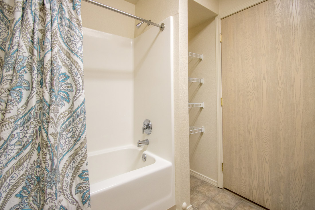 Shower and Tub Combination at Chapel Ridge of Marion Apartments in Marion, IA