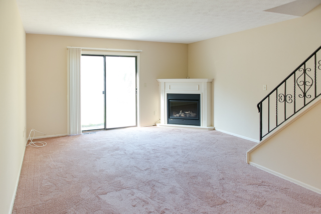 Living Room and Fireplace at the Chartwell Townhouse Estates in Rochester, NY