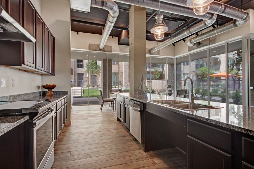 Fully Equipped Kitchen at City Square Lofts Apartments in Garland, TX