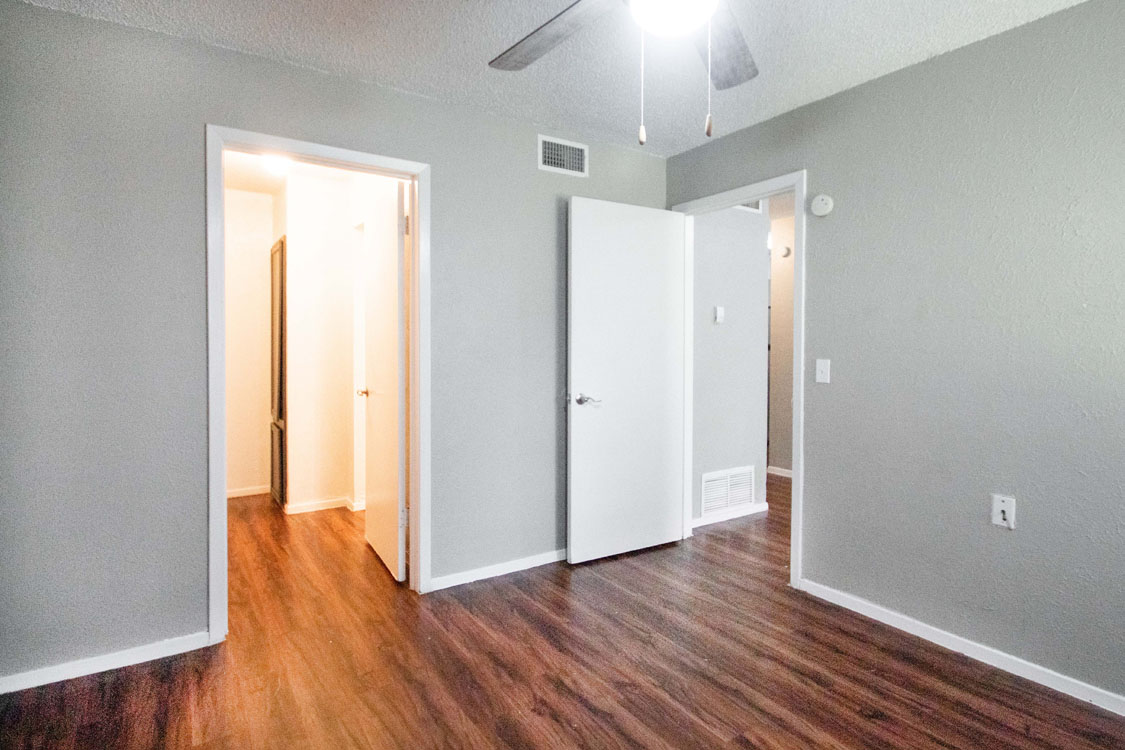 Bedrooms with Plank Flooring at Courtyard Park in Abilene, Texas
