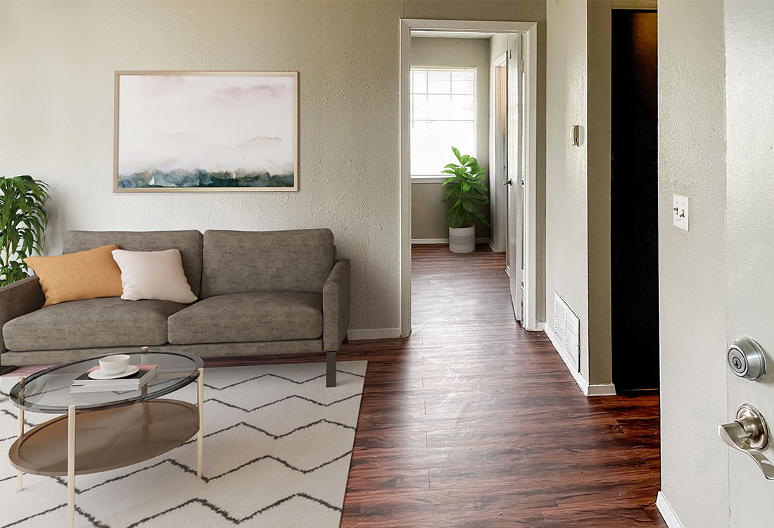 Living Room with Wood-Look Flooring at Courtyard Park Apartments in Abilene, TX