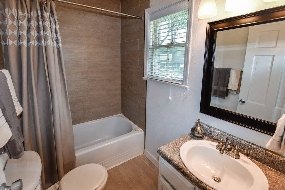 Shower and Tub Combination at Crestwood Place Apartments in Fort Worth, TX