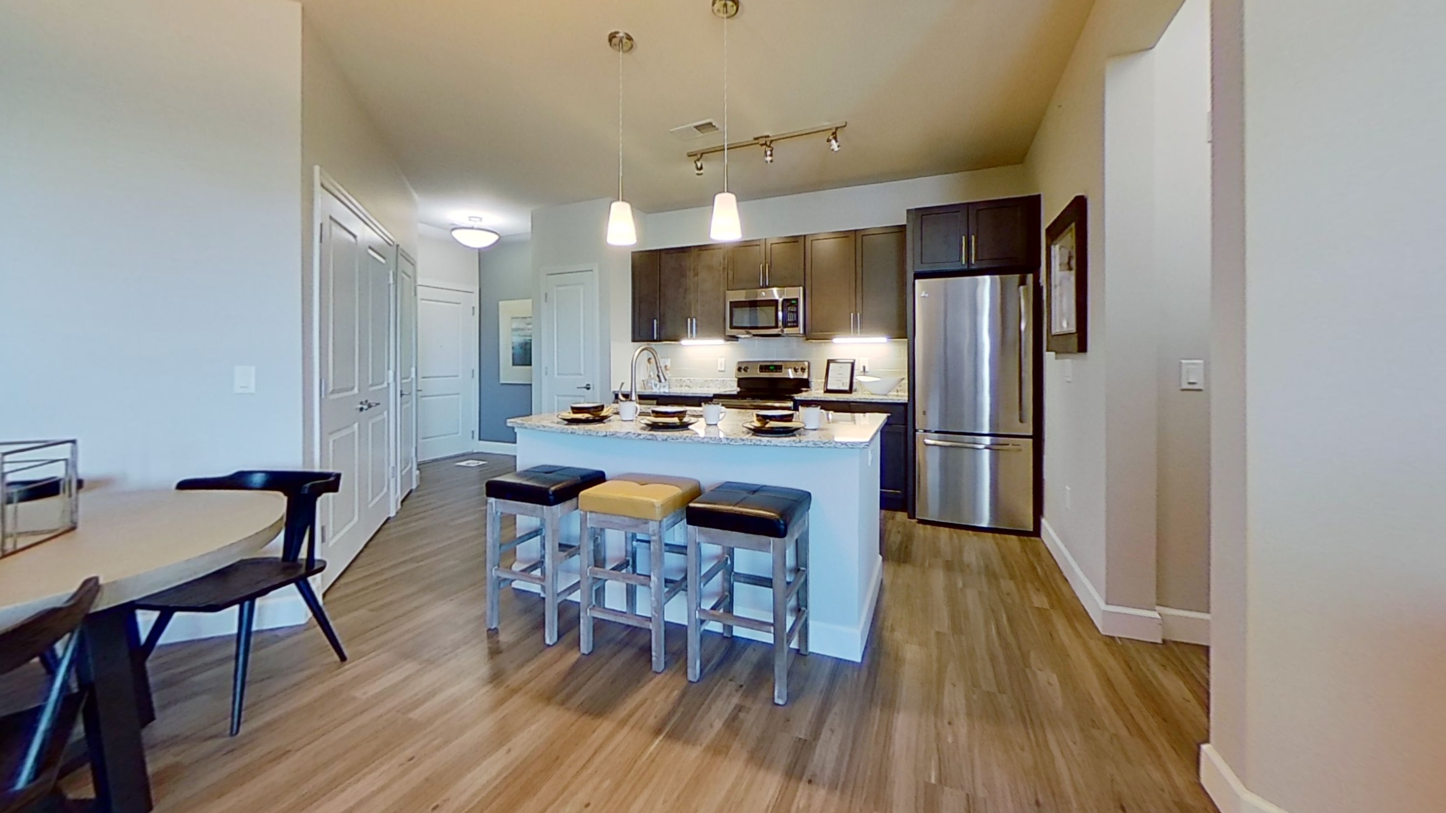 A3 Unit Kitchen and Dining Area at the Vue at Creve Coeur Apartments in Creve Coeur, MO